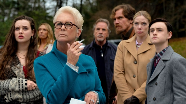 """Katherine Langford, Toni Collette, Jamie Lee Curtis, Don Johnson, Michael Shannon, Riki Lindholm and Jaeden Lieberher in a scene from """"Knives Out."""" (Claire Folger/Lionsgate via AP)"""