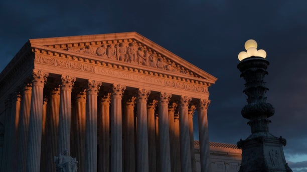 In this Jan. 24, 2019, file photo, the Supreme Court is seen at sunset in Washington. The Supreme Court is preventing the Trump administration from re-starting federal executions next week after a 16-year break. The court on Friday denied the administration's plea to undo a lower court ruling in favor of inmates who have been given execution dates. (AP Photo/J. Scott Applewhite, File)