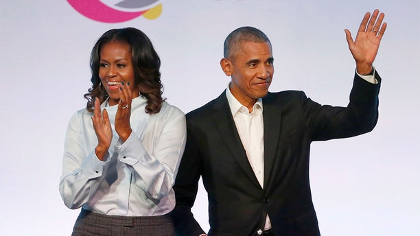 Former first lady Michelle Obama may have rejected the first version of the official portrait of former President Barack Obama. (AP)