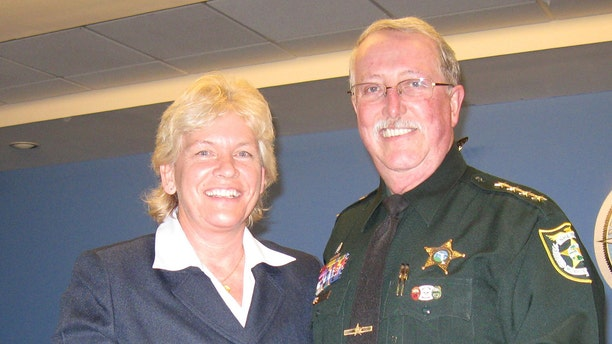 Capt. Penny Phelps, left, in a photo from 2012.