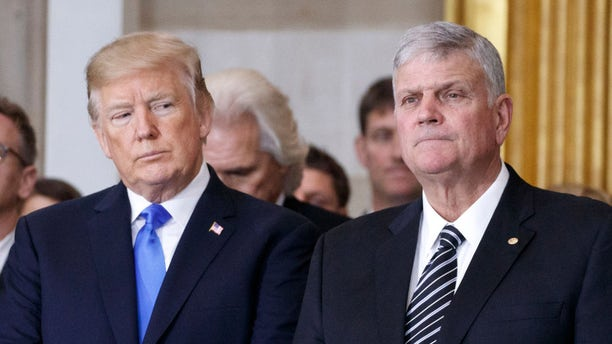President Donald Trump and first lady Melania Trump stand with Franklin Graham during a ceremony as the late evangelist Billy Graham lies in repose at the U.S. Capitol, on February 28, 2018 in Washington, DC. (Photo by Shawn Thew-Pool/Getty Images)