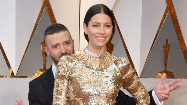 """Justin Timberlake and Jessica Biel arrive at the 2017 Oscars, where Timberlake's """"Can't Stop the Feeling"""" was nominated for Best Original Song.(VALERIE MACON/AFP via Getty Images)"""