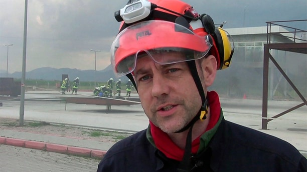 In this image taken from file video, James Le Mesurier, founder and director of Mayday Rescue, talks to the media during training exercises in southern Turkey, March 19, 2015. Le Mesurier was found dead in Istanbul last month on a street below his apartment. (AP Photo, FILE)