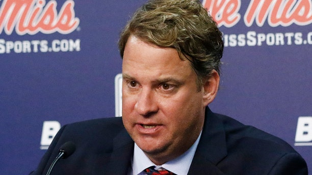 Lane Kiffin responds to reporters questions at a news conference, after being introduced to Mississippi fans as their new NCAA college football coach, at The Pavilion, a multipurpose arena on the campus in Oxford, Miss., Monday, Dec. 9, 2019. Kiffin was previously, the football coach for three years at Florida Atlantic. (AP Photo/Rogelio V. Solis)