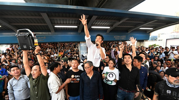 Thailand's Future Forward Party leader Thanathorn Juangroongruangkit talks to his supporters during a rally in Bangkok, Thailand, Saturday, Dec. 14, 2019. Several thousand supporters of a popular Thai political party, under threat of dissolution, packed a concourse in central Bangkok on Saturday in one of the largest political demonstrations in recent years.