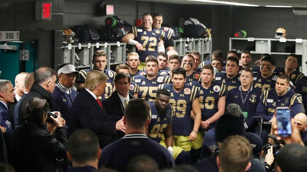 President Donald Trump greets the Navy football team in Philadelphia, Saturday, Dec. 14, 2019, before the Army-Navy college football game. (AP Photo/Jacquelyn Martin)