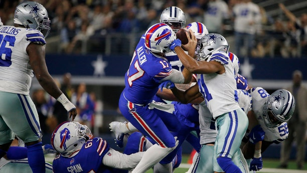 Buffalo Bills quarterback Josh Allen (17) fights for a first down after recovering a fumbled snap as Dallas Cowboys cornerback Byron Jones (31) defends in the first half of an NFL football game in Arlington, Texas, Thursday, Nov. 28, 2019.