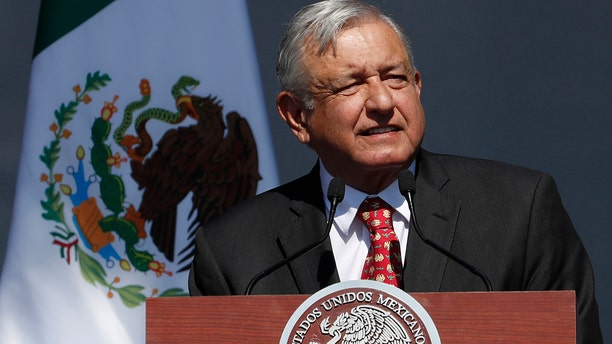 Mexico's President Andres Manuel Lopez Obrador speaks during rally to commemorate his one year anniversary in office, at the capital's main plaza, the Zocalo, in Mexico City, Sunday, Dec. 1, 2019. (AP Photo/Marco Ugarte)