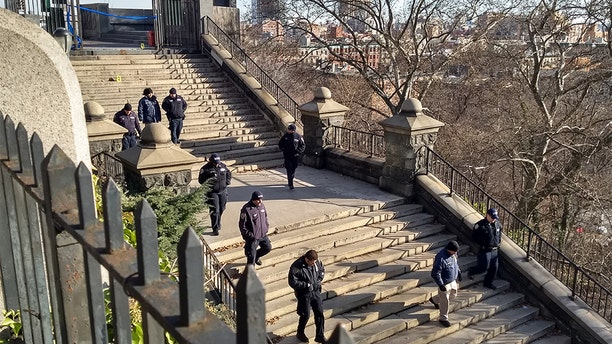 Officers from the New York City Police Department inspect a crime scene where an 18-year-old college student was stabbed to death Wednesday night.