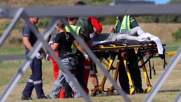 Emergency services attend to an injured person arriving at the Whakatane Airfield after the volcanic eruption Monday, Dec. 9, 2019, on White Island, New Zealand.