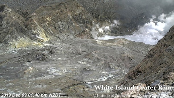 In this image released by GeoNet, tourists can be seen near the volcano's crater Monday, Dec. 9, 2019, on White Island, New Zealand.