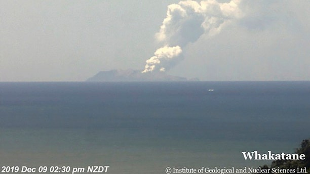 This image released by GNS Science, shows plumes of smoke from a volcanic eruption on White Island, seen from Whakatane, New Zealand Monday, Dec. 9, 2019.