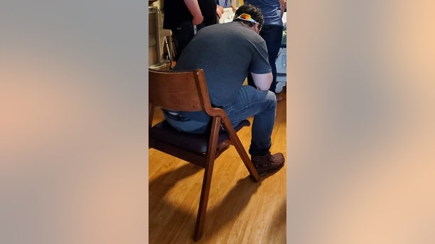 She updated the post to clarify that the man seated was her husband mourning the loss of his older brother.