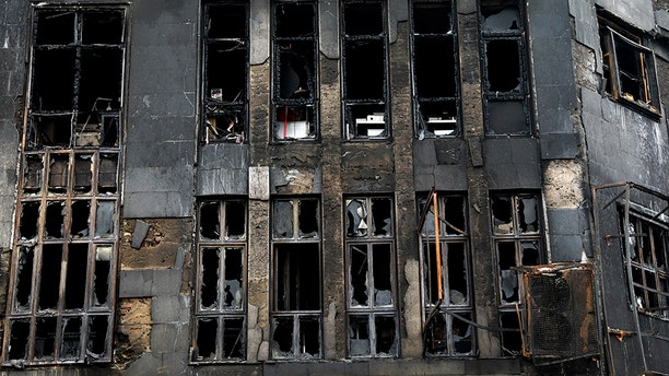 Shattered windows line a building that was set ablaze during protests over government-set gasoline prices rises, in Tehran, Iran, on Nov. 20. (AP)