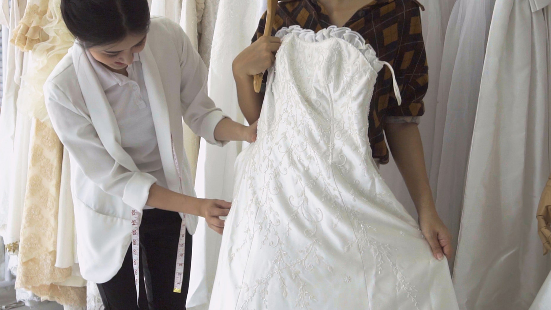 An anonymous bride is claiming her mother and sister in law took turns trying on her dream dress without her permission.
