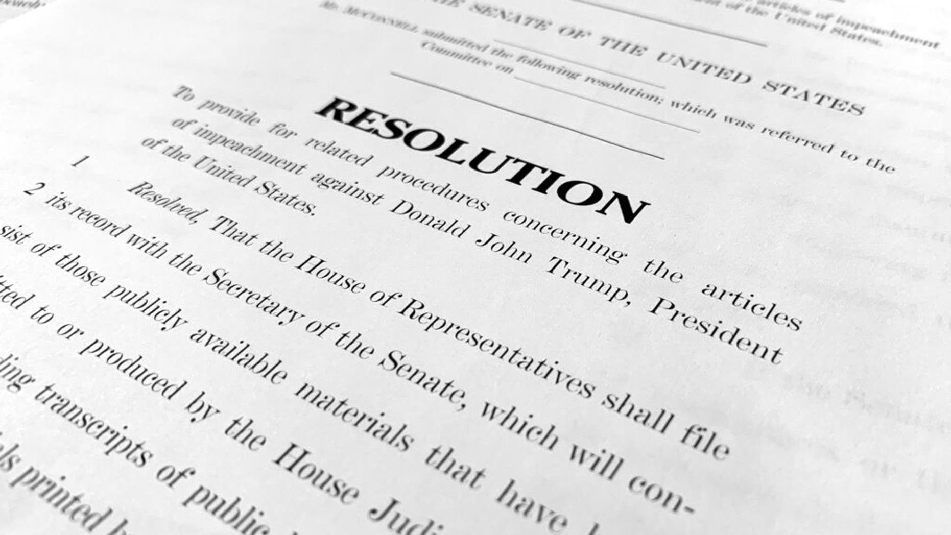 A copy of a Senate draft resolution to be offered by Senate Majority Leader Mitch McConnell, R-Ky., regarding the procedures during the impeachment trial of President Donald Trump in the U.S. Senate. (AP Photo/Jon Elswick)