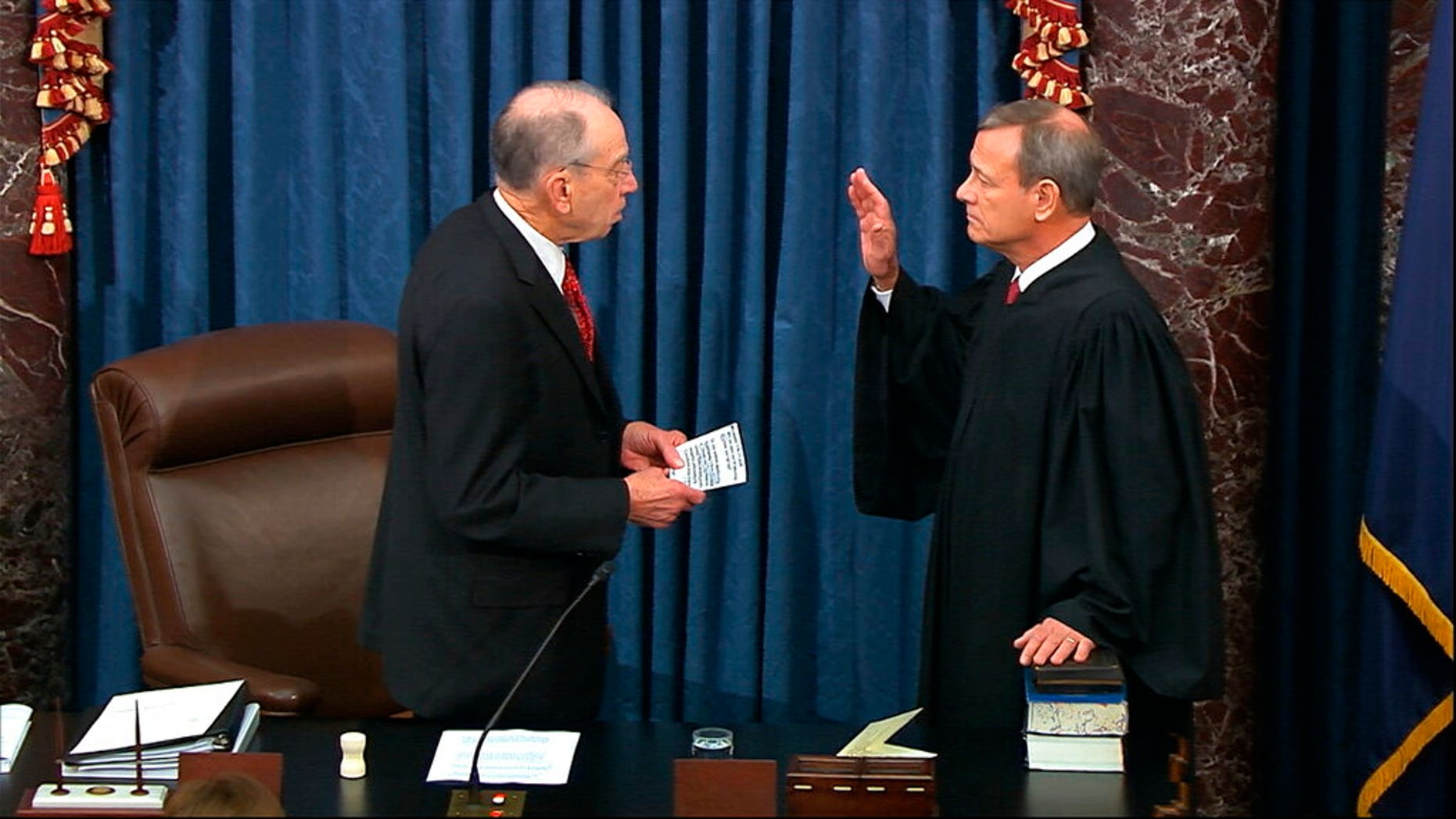 In this image from video, President Pro Tempore of the Senate Sen. Chuck Grassley, R-Iowa., swears in Supreme Court Chief Justice John Roberts as the presiding officer for the impeachment trial of President Trump in the Senate at the U.S. Capitol in Washington, Thursday, Jan. 16, 2020. (Senate Television via AP)