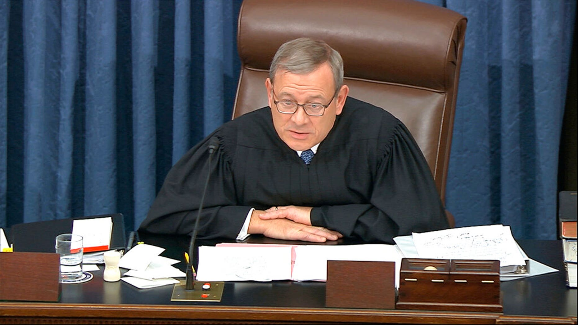 Supreme Court Chief Justice John Roberts admonishes the impeachment managers and president's counsel in equal terms as he speaks during the impeachment trial against President Donald Trump in the Senate. (Senate Television via AP)