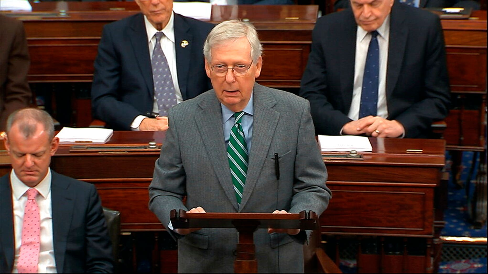 In this image from video, Majority Leader Sen. Mitch McConnell, R-Ky., speaks as the impeachment trial against President Donald Trump begins in the Senate at the U.S. Capitol in Washington, Thursday, Jan. 16, 2020. (Senate Television via AP)