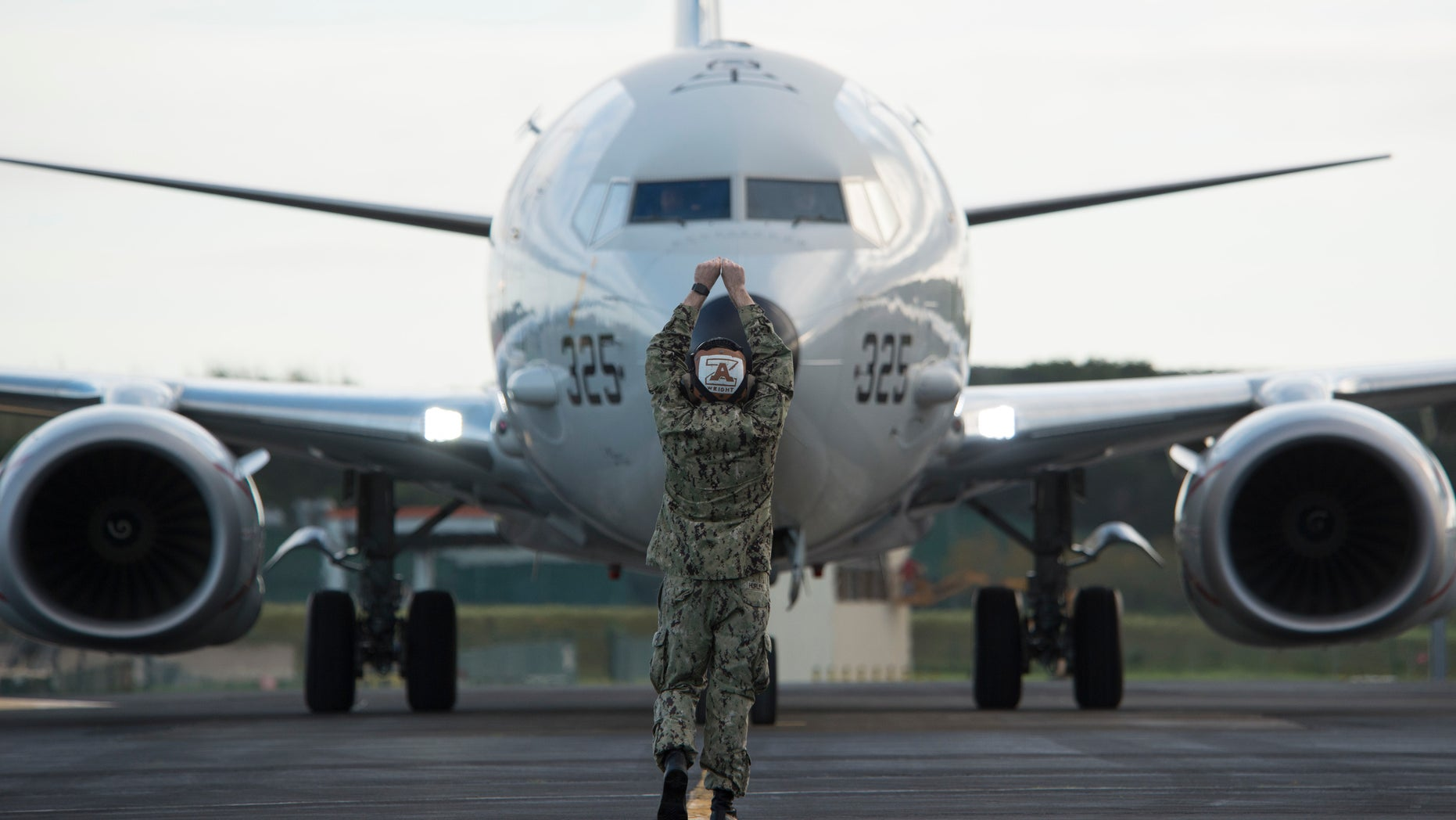 Aviation Maintenance Administrationman 3rd Class Shea Wright, assigned to the Skinny Dragons of Patrol Squadron (VP) 4, recovers a squadron P-8A Poseidon maritime patrol and reconnaissance aircraft following an anti-submarine warfare mission over the Atlantic Ocean, Nov. 30, 2019. - file photo.
