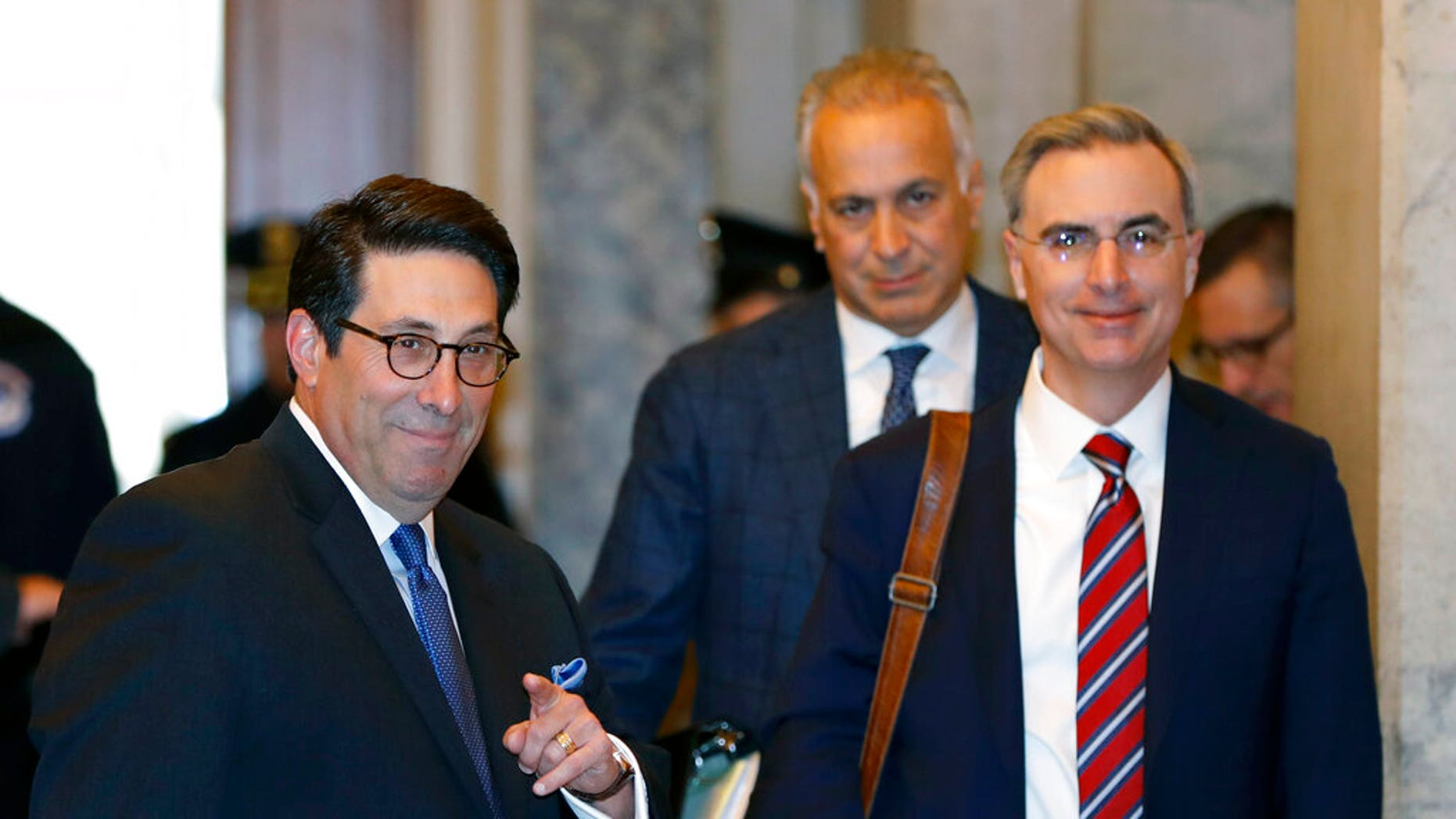 President Trump's personal attorney Jay Sekulow, left, gestures while standing with White House Counsel Pat Cipollone, right, while arriving at the Capitol in Washington. (AP Photo/Julio Cortez)