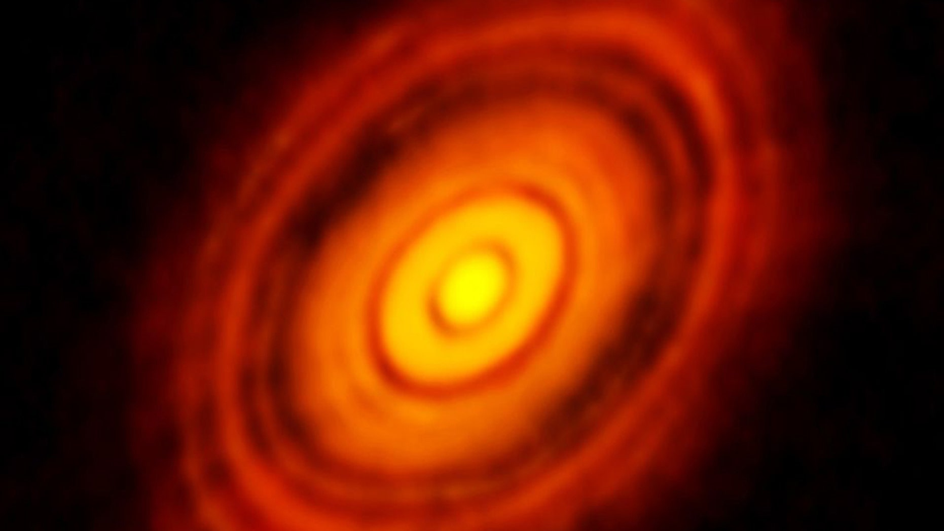 The Atacama Large Millimeter/Submillimeter Array (ALMA) in Chile captured this picture of disks that formed around a young star about 450 light years away from our planet. Now, scientists are proposing that similar disks could have formed around our sun in the early solar system, creating the seeds for our planets. (Credit: ALMA (ESO/NAOJ/NRAO), NSF)