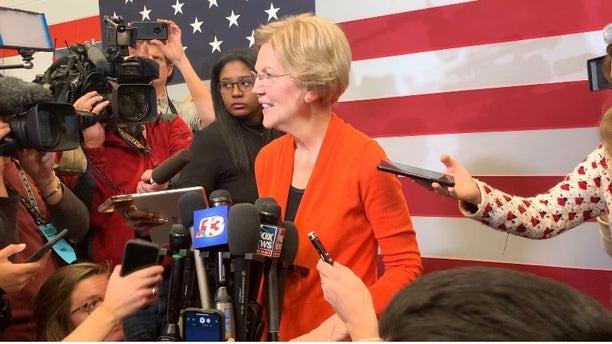 Democratic presidential candidate Sen. Elizabeth Warren speaks with reporters while campaigning in Marshalltown, Iowa on Jan. 12, 2019
