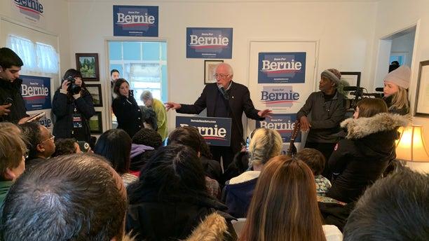 Democratic presidential candidate Sen. Bernie Sanders of Vermont speaks with reporters in Des Moines, Iowa on Dec. 31, 2019