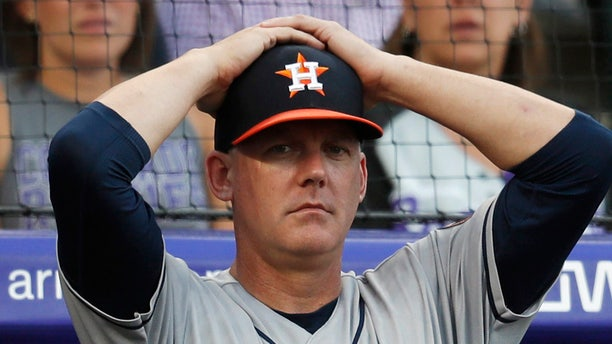 FILE - In this July 2, 2019, file photo, Houston Astros manager AJ Hinch reacts during a baseball game against the Colorado Rockies, in Denver. Houston manager AJ Hinch and general manager Jeff Luhnow were suspended for the entire season Monday, Jan. 13, 2020, and the team was fined $5 million for sign-stealing by the team in 2017 and 2018 season. (AP Photo/David Zalubowski, File)