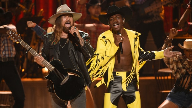 "This June 23, 2019 file photo shows Billy Ray Cyrus, left, and Lil Nas X performing ""Old Town Road"" at the BET Awards in Los Angeles. The 2020 Grammy Awards are shaping up to be the night of the new kids, with Lizzo, Billie Eilish and Lil Nas X leading in nominations."