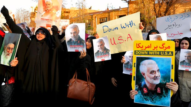 Protesters chanting slogans and holding up posters of Gen. Qassem Soleimani during a demonstration in front of the British Embassy in Tehran on Sunday.