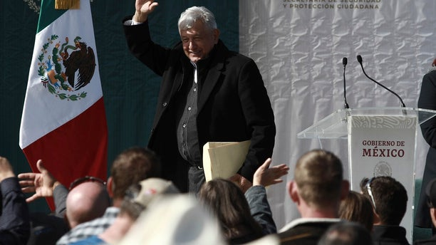 Mexico's President Andres Manuel Lopez Obrador waves to residents during his visit to the small town of La Mora, Sonora state, Mexico. Lopez Obrador said Sunday there is an agreement to establish a monument will be put up to memorialize nine U.S.-Mexican dual citizens ambushed and slain last year by drug gang assassins along a remote road near New Mexico. (AP Photo/Christian Chavez)