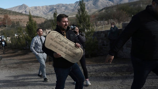 "Lenzo Widmar carries a sign that reads in Spanish: ""Without just punishment for crime, freed is without defense"" at the small town of La Mora, Sonora state, Mexico last week. (AP Photo/Christian Chavez)"