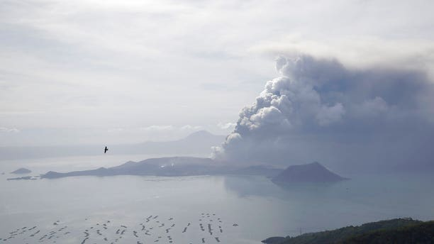 Taal Volcano continues to spew ash on Monday Jan. 13, 2020, in Tagaytay, Cavite province, south of Manila, Philippines. (AP Photo/Aaron Favila)