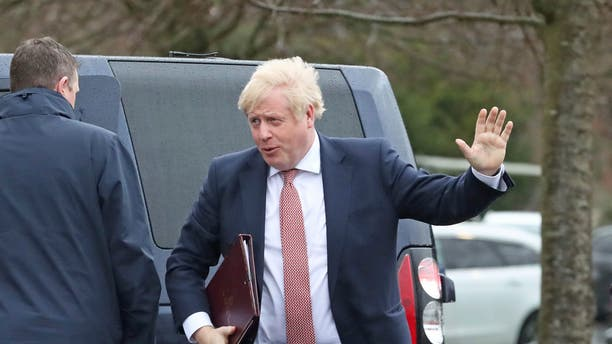 Britain's Prime Minister Boris Johnson visits Stormont, Belfast, Northern Ireland, Monday Jan. 13, 2020, as the power-sharing Northern Ireland assembly starts up.