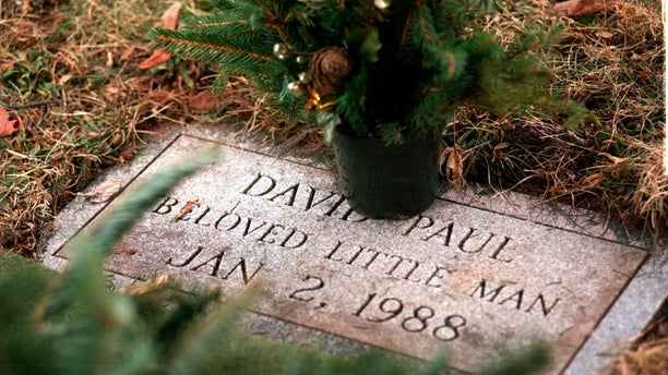 A January 1998 photo shows the grave of David Paul at Walnut Grove Cemetery in Meriden, Conn. The abandoned newborn infant was found frozen to death in a Meriden parking lot. DNA testing has helped police identify the mother of the infant but she is not expected to face charges because of the age of the crime, authorities announced Tuesday. (Tony Bacewicz/Hartford Courant via AP)