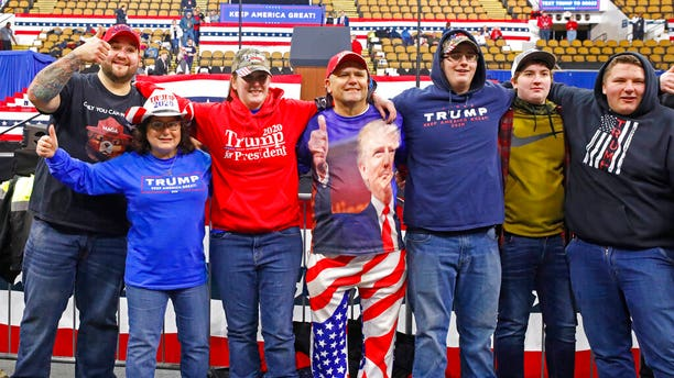 A group takes a picture in the front row as they arrive for a campaign rally with President Donald Trump Tuesday, Jan. 14, 2020, in Milwaukee. (AP Photo/Jeffrey Phelps)