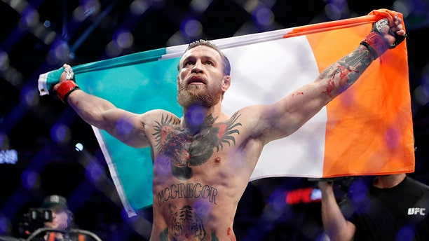 """Conor McGregor celebrates after defeating Donald """"Cowboy"""" Cerrone during a UFC 246 welterweight mixed martial arts bout Saturday, Jan. 18, 2020, in Las Vegas. (Associated Press)"""