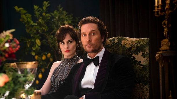 "Michelle Dockery, left, and Matthew McConaughey in a scene from ""The Gentlemen."""