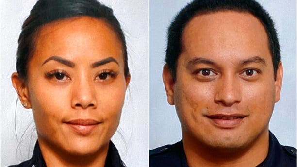 This undated photo provided by the Honolulu Police Department shows Officers Tiffany Enriquez, left, and Kaulike Kalama. Enriquez and Kalama were killed Sunday, Jan. 19, 2020, while responding to a call.