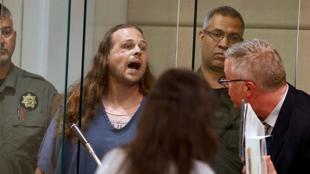 In this 2017 photo, Jeremy Christian shouts as he is arraigned in Multnomah County Circuit Court in Portland, Ore. (Beth Nakamura/The Oregonian via AP, Pool, File)