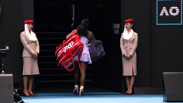 Serena Williams of the U.S. leaves Rod Laver Arena after the third round single loss to China's Wang Qiang at the Australian Open tennis championship in Melbourne, Australia, Friday, Jan. 24, 2020. (AP Photo/Lee Jin-man)