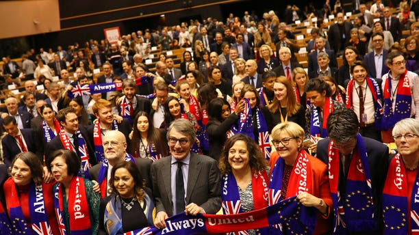 European Parliament President David Sassoli, center, stands with other British MEP's and members of the political group Socialist and Democrats as they participate in a ceremony prior to the vote on the UK's withdrawal from the EU at the European Parliament in Brussels, Wednesday, Jan. 29, 2020.