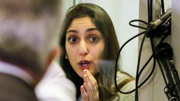 Israeli Naama Issachar gestures during an appeal hearing in a courtroom in Moscow, Russia.