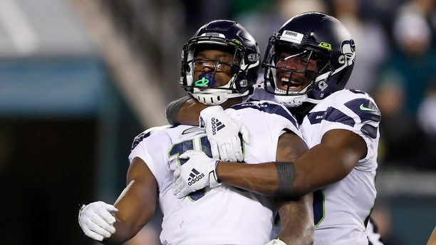 Seattle Seahawks' D.K. Metcalf, left, and David Moore celebrating after Metcalf's touchdown catch against the Philadelphia Eagles on Sunday. (AP Photo/Julio Cortez)