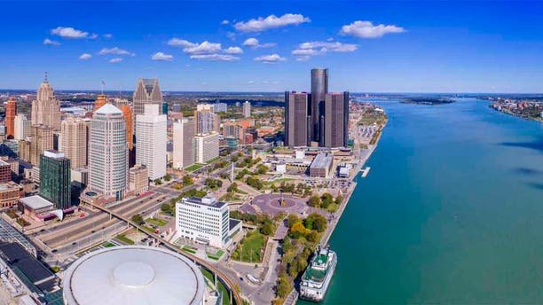 A man from the United Kingdom who was previously deported from the U.S. was arrested last month after swimming in a wetsuit from across the Detroit River into Michigan, according to federal prosecutors.