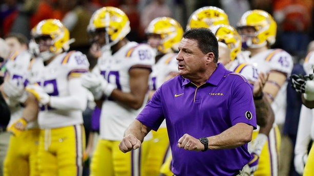 LSU head coach Ed Orgeron watches during warm ups before a NCAA College Football Playoff national championship game against Clemson Monday, Jan. 13, 2020, in New Orleans. (AP Photo/Sue Ogrocki)