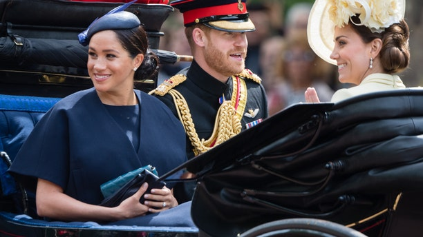 Prince Harry, Duke of Sussex. Meghan, Duchess of Sussex and Catherine, Duchess of Cambridge ride by carriage down the Mall during Trooping The Colour, the Queen's annual birthday parade, on June 08, 2019 in London, England.