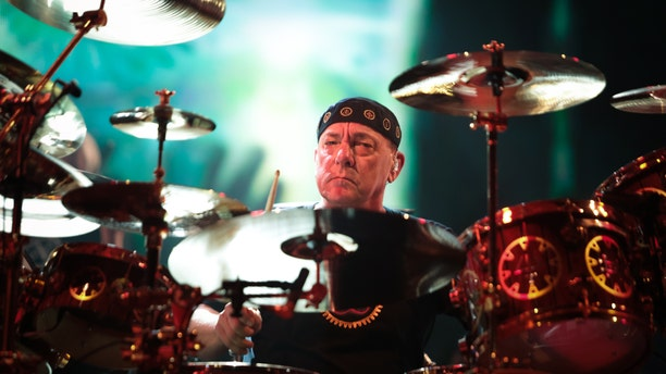 Neil Peart of Rush performs on stage at O2 Arena on May 24, 2013 in London, England. (Photo by Christie Goodwin/Redferns via Getty Images)