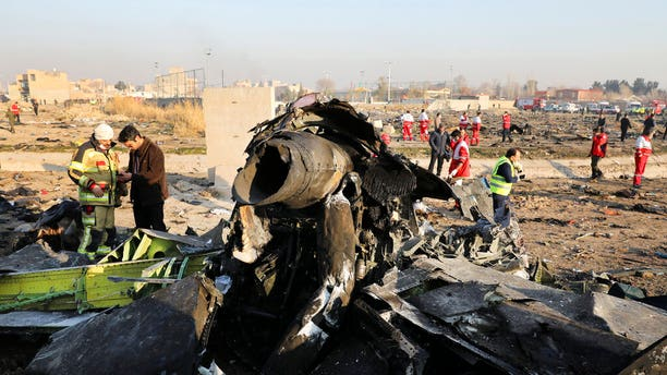 FILE - In this Wednesday, Jan. 8, 2020 file photo debris at the scene where a Ukrainian plane crashed in Shahedshahr southwest of the capital Tehran, Iran. (AP Photo/Ebrahim Noroozi)